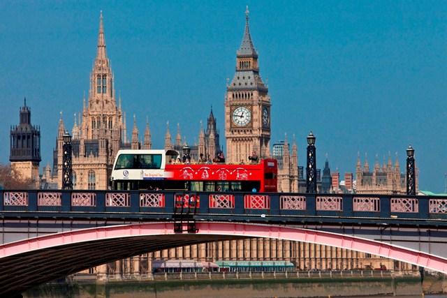 London City Sightseeing Bus cruises passed Big Ben