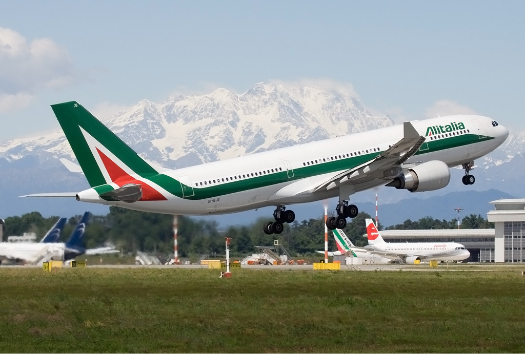 Alitalia airline taking off on the runway